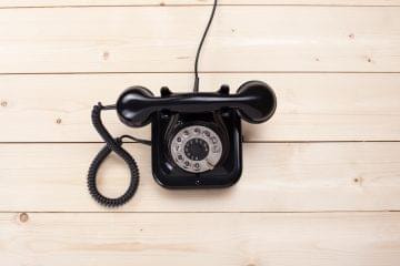 Old,Retro,Black,Phone,On,Wooden,Board,,Top,View,,Dof,