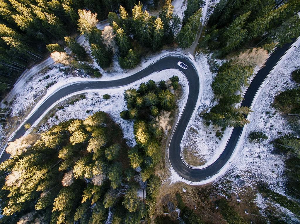 Aerial,View,Of,Snowy,Forest,With,A,Road.,Captured,From