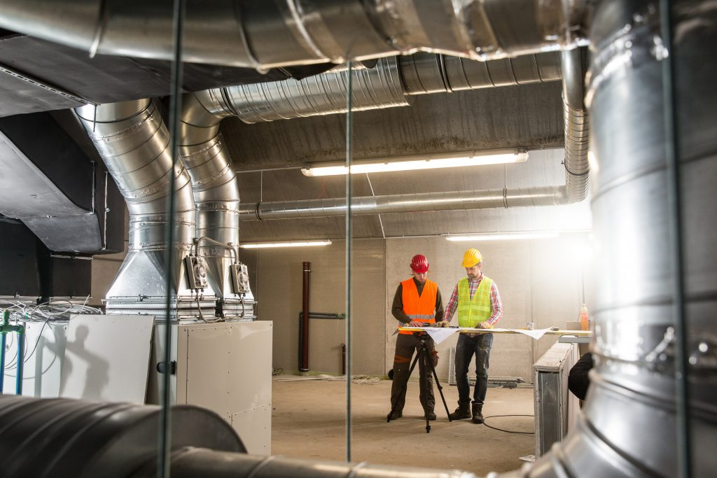 Workers,Making,Final,Touches,To,Hvac,System.,Hvac,System,Stands